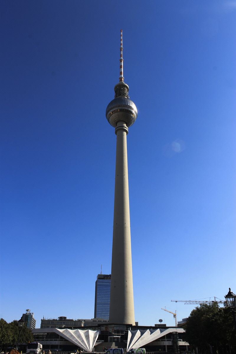 The Alexanderplatz tower reminds you of the CN tower in Toronto: a tall single cement spike with a ball on the top, a compass needle perhaps or a beacon for the future. Much better than building a wall!