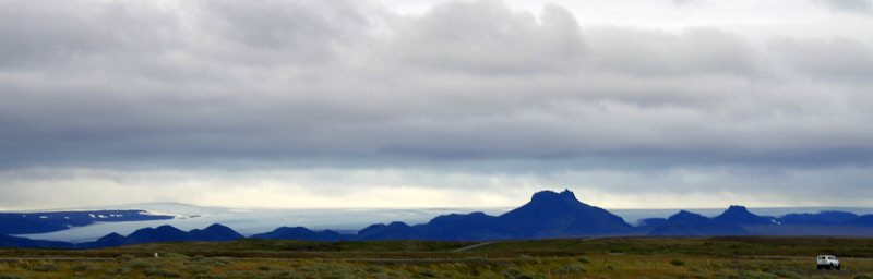 Clouds, the ocean, dark lava rocks and tough foliage create an awesome vision on this island so aptly named Iceland!