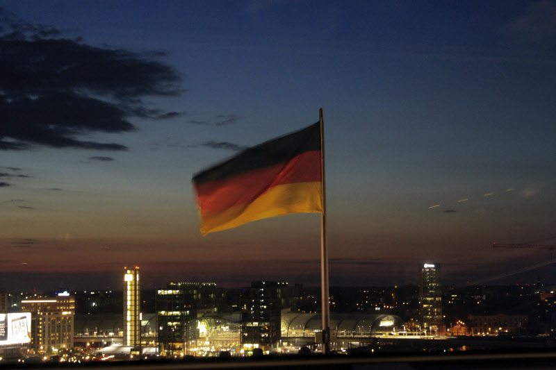 The evening sky with the German flag glowing with the lights from the city below, a Reichstag moment!