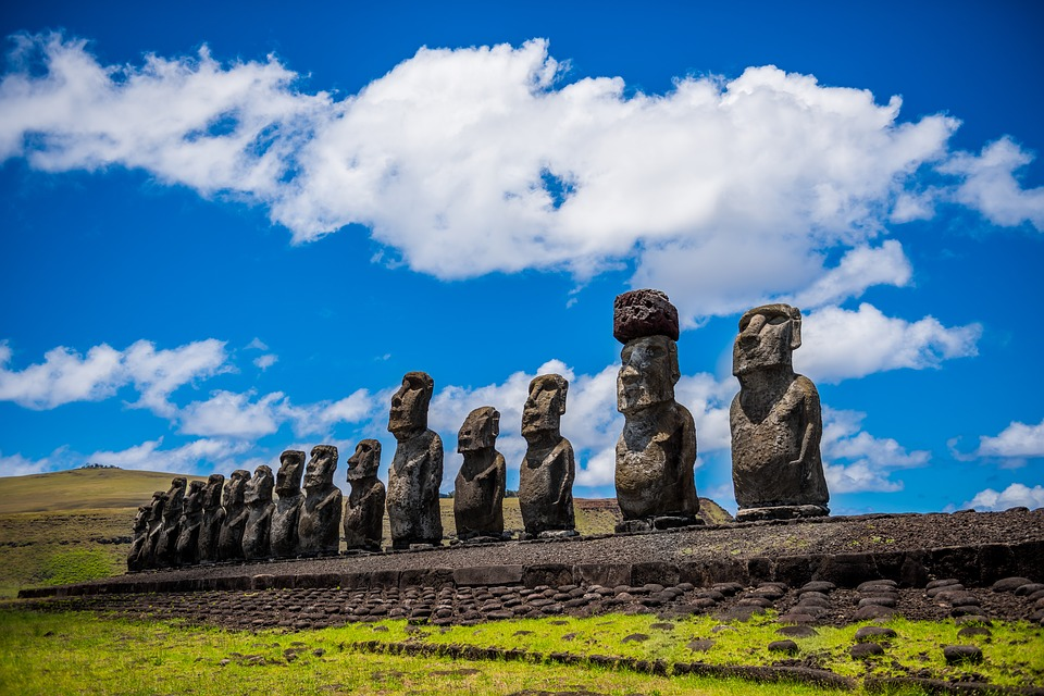 moai easter island rapa nui ancestral ancestors ceremonial old rapa travel sculpture nui chile hangaroa remoteness mohais sky clouds blue landscape grass rock fields blue sky green nature statue rituals mystery easter island easter island easter island easter island easter island chile