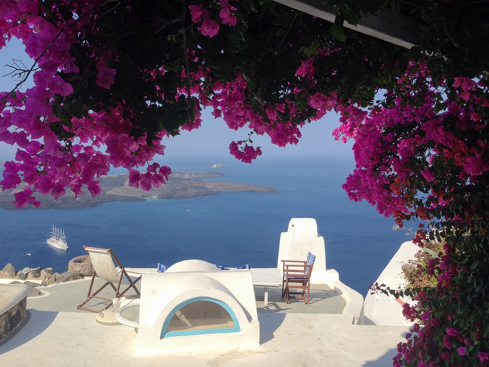 island greece santorini flowers blue travel sea mediterranean sea landscape mediterranean color light white water aeolian island tourism architecture cyclades rest hot paradise sun greece greece greece greece greece santorini santorini paradise